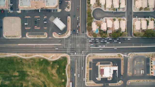 bird-s-eye-view-cars-crossing-crossroad